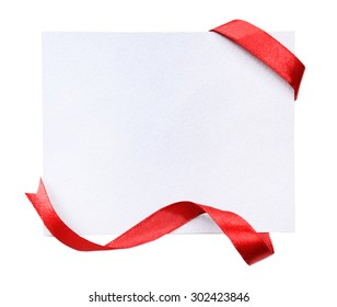 Shiny red ribbon with card isolated on white