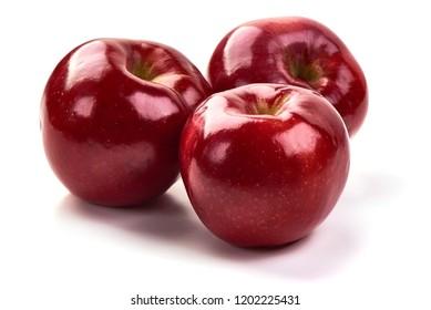 Shiny Red ripe apples, isolated on white background. Fresh raw organic fruits. Close-up.
