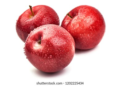 Shiny Red ripe apples with water drops, isolated on white background. Fresh raw organic fruits. Close-up