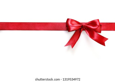 Shiny red satin ribbon and bow isolated on white background