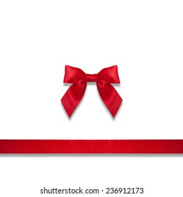 Shiny red satin ribbon and bow close up on white background