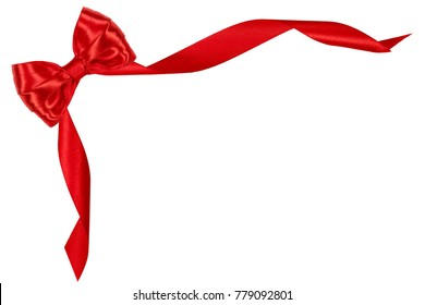 Shiny red satin ribbon bow on white background