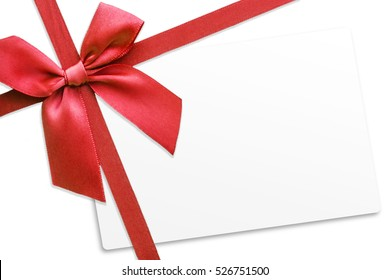 Shiny red satin ribbon on white background with white card.