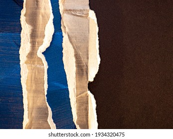 Shiny ripped and crumpled paper backdrop with brush strokes and paint texture.
