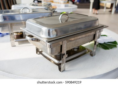 shiny roaster on a white table
