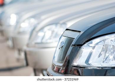 A shiny row of cars.