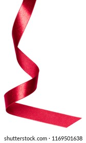 Shiny satin ribbon in red color isolated on white background close up