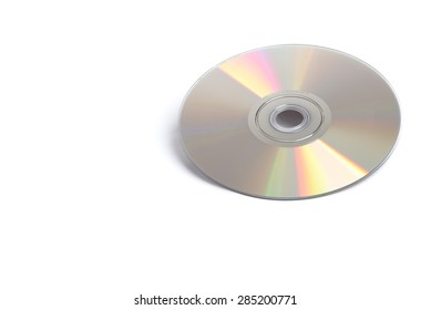 A shiny silver DVD sitting alone on a white background.