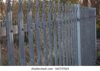 Shiny silver gate with protective spikes