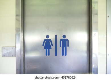 Shiny stainless steel toilet door on the old train in Thailand.