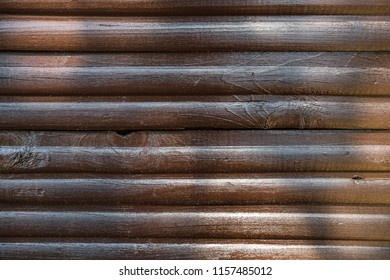 Shiny varnished stripped brown wooden planks as texture. Abstract natural background
