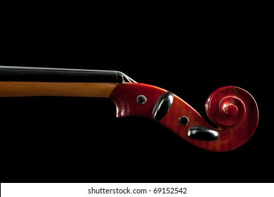 shiny violin scroll closeup isolated on black background