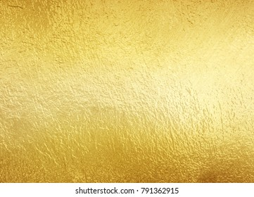 Shiny yellow gold foil texture background