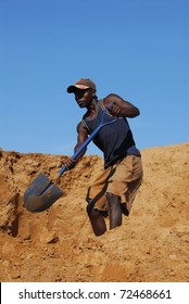 SHINYANGA, TANZANIA-MARCH 18: An unidentified miner shovels sand March 18, 2010 in Shinyanga, Tanzania. Tanzania is the third gold producer in Africa after Ghana and South Africa.