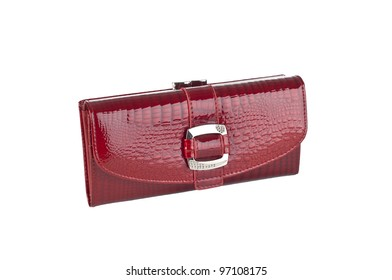 Shinyl red handbag with alligator pattern, silver buckle on white background