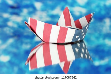 Ship of the American flag, on blue background. Columbus Day.