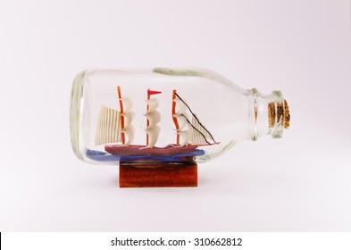 Ship in a Bottle isolated on a white background.