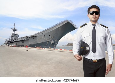 Ship captain in uniform with battleship