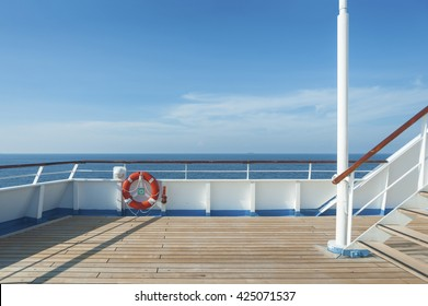 Ship deck, buoy and blue ocean. Travel background