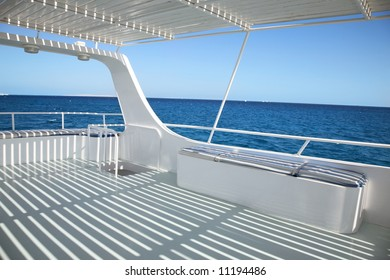 ship deck with striped  shadowo on blue sea background