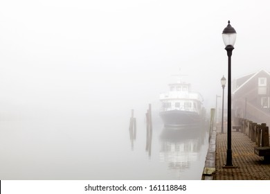 Ship Docked in the Fog. Davis park ferry docked  at Sandspit Marina, Patchogue, Long Island, New York.