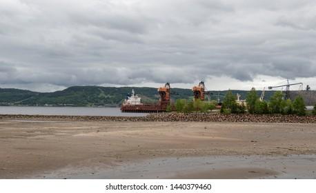 ship docked at la Baie Saguenay Quebec under dark stormy sky