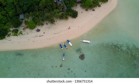The ship docked on the coast of the island Sangalaki - aerial photos of the drone mavic pro. Sangalaki is one of the islands in the Derawan archipelago.. Consisting of derawan island, maratua, kakaban