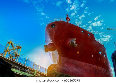 ship forward in the floating dry dock the overhaul in shipyard, under blue sky background