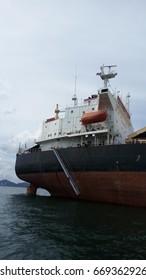 Ship gangway beside the big ship cargo on the sea, Orange life boat on big ship cargo, Draft survey