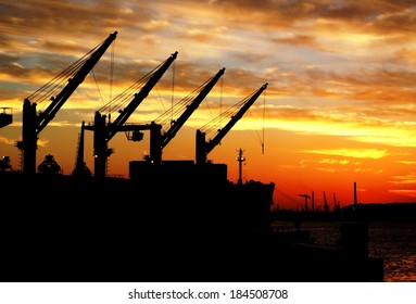 Ship loading cargo in the Port of Rotterdam at Sunset