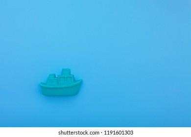 ship made magic sand on blue background