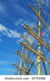 A ship mast against a blue sky