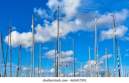 Ship masts against blue cloudy sky. Port of Barcelona, Spain