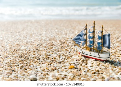 Ship model on summer sunny beach. Travel, voyage, vacation concepts
