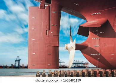 ship moored on sleeper At Stern ship Propeller with rudder under Reconstruction, Under the ship, Big ship under Repair on floating dry dock in shipyard