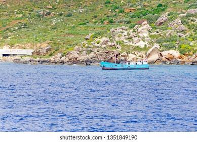 Ship near Port of Mgarr on the small island of Gozo, Malta.