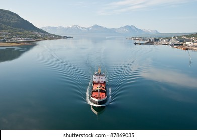 Ship in Tromsö¶, Norway, with panorama view to mountains in the background
