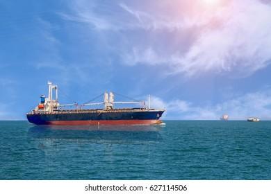 ship in ocean on sky blue background