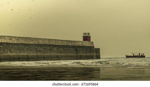 A ship on the coast of Arabian sea; a ship in the sea, A ship heading back home in bad weather