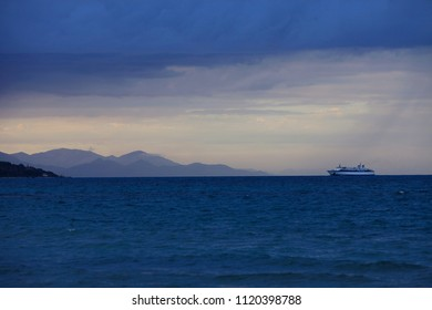 A ship on the horizon in the rain off the coast of the island of Zakynthos in Greece