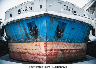 The ship on the winter sludge close-up. Ship in a frozen river. Ships in ice.