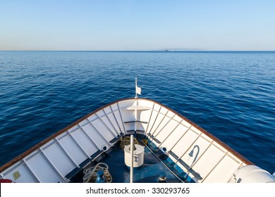 Ship in open sea is showing the bow in a summer day