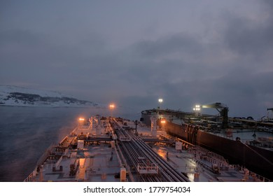 Ship to ship operations in cold, arctic conditions in the early morning, 140 thousand and 300 thousand mt deadweight tankers.