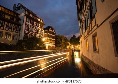 Ship passing bridge in Strasbourg at night