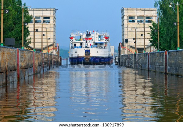 The ship passing through a lock on the river.