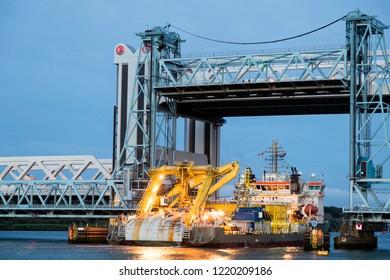 Ship passing under bascule bridge