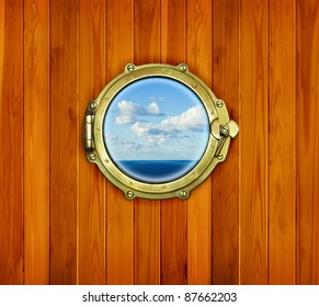 Ship porthole window with seascape ocean. Brass porthole at the old sailing vessel.