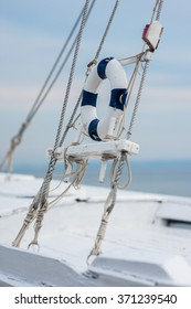 Ship railing and lifebuoy ring white and blue