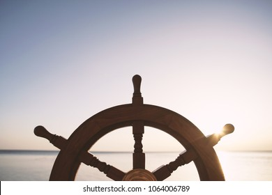 Ship rudder with sea on background.