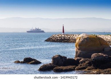 Ship sailing in front of the breakwater of vilaxoan harbor, Arousa estuary